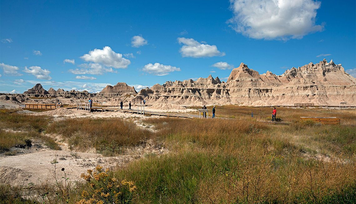 Park visitors exploring the Fossil Exhibit Trail in Badlands National Park