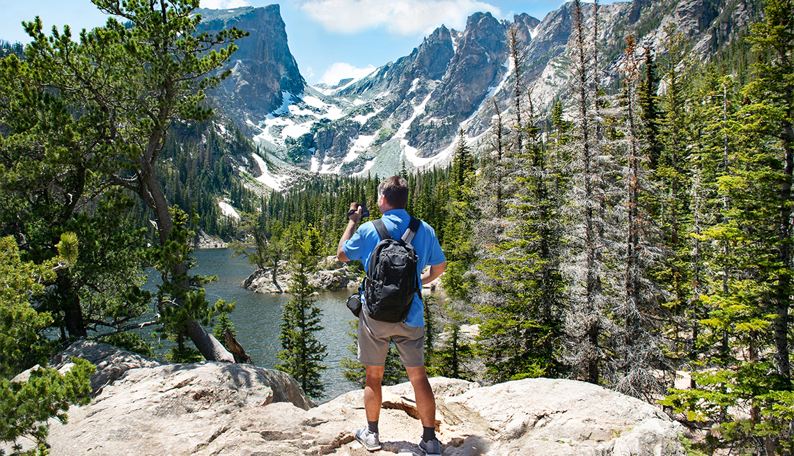 Man standing on top of the mountain looking at Dream Lake, Rocky Mountains National Park