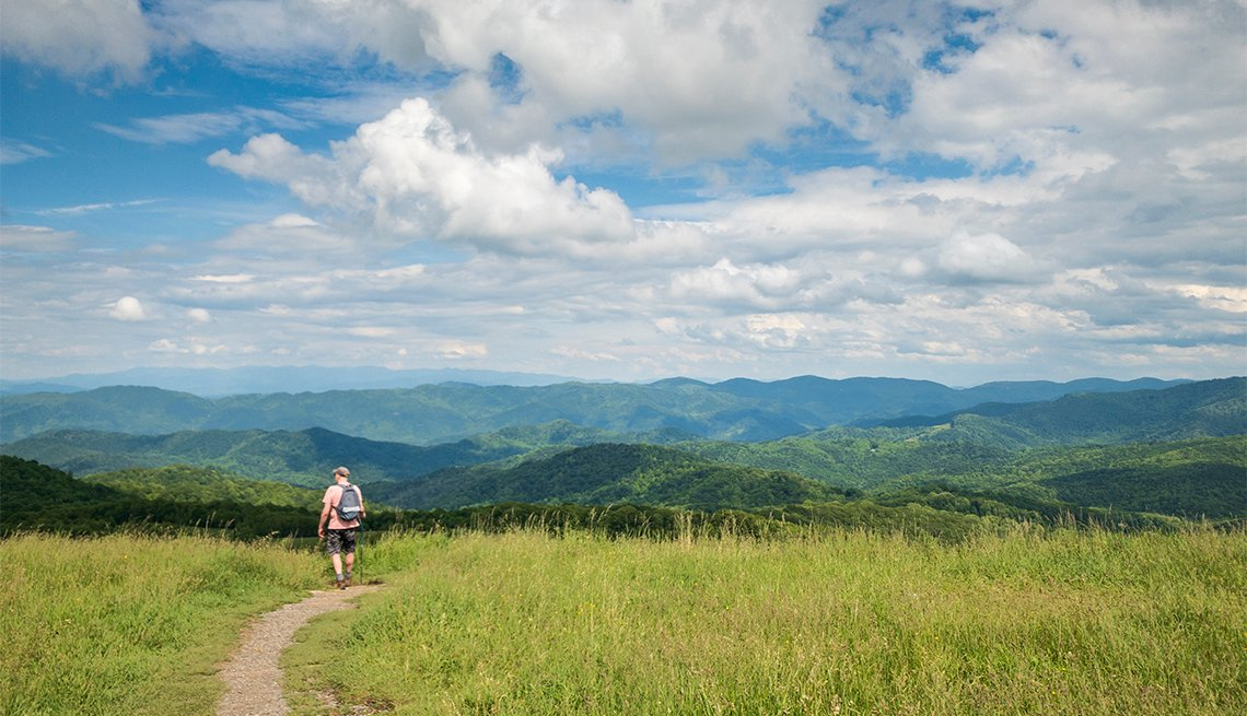 Hiking the Appalachian Trail with view of Smoky Mountains ,   on Max Patch Bald Mountain, North Carolina