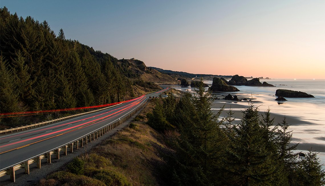 Cars traveling along the Samuel H. Boardman Scenic Corridor in Oregon