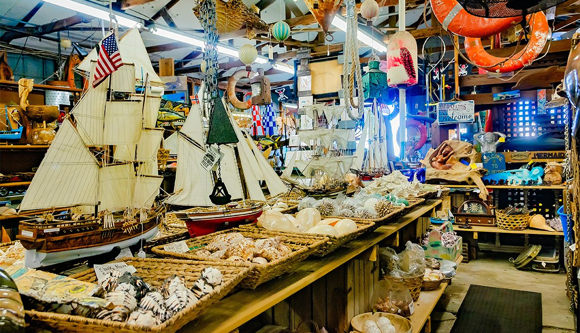 Seashells, model ships, nautical souvenirs, and memorabilia are crowded onto shelves in Apalachicola, Florida
