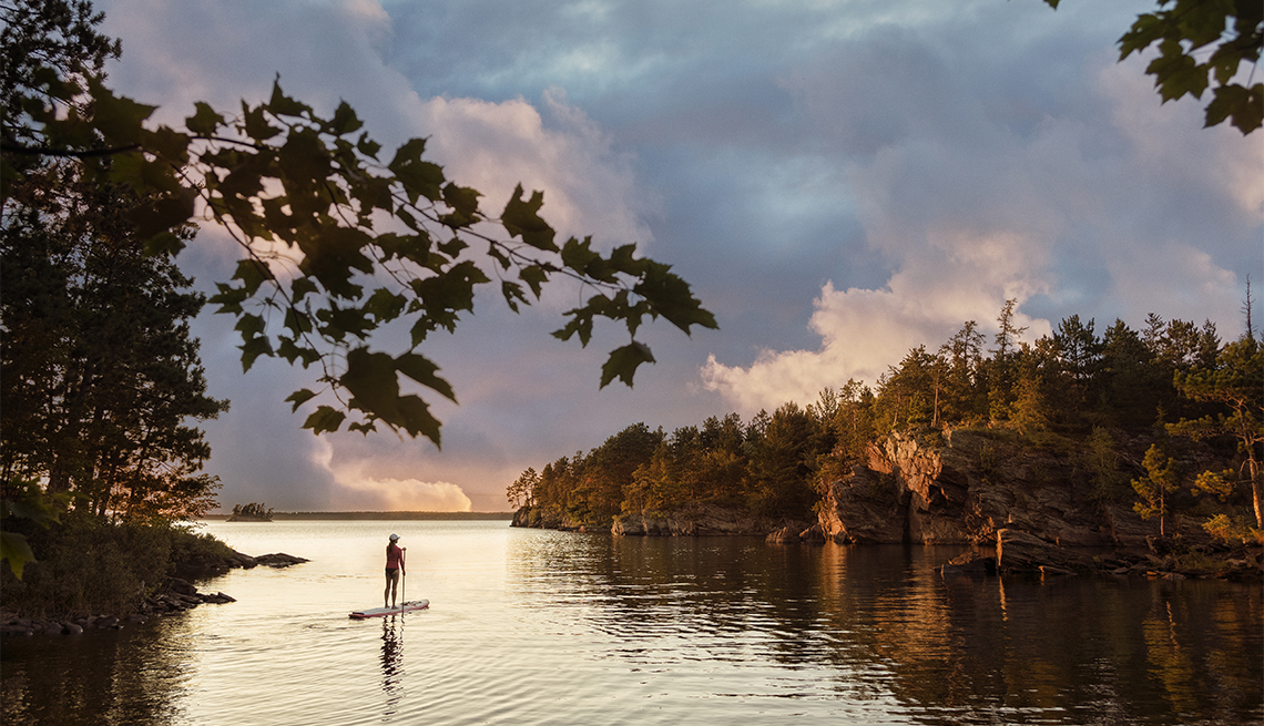 item 6 of Gallery image - paddleboarder at Voyageurs National Park