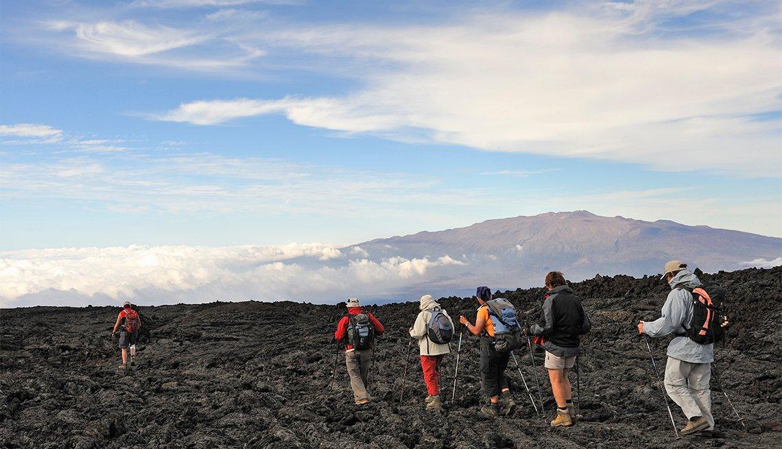 item 5 of Gallery image - Group of hickers walking on cooled lava, Mauna Loa Volcano (Mauna Kea in the background), Big Island, Hawaii Islands