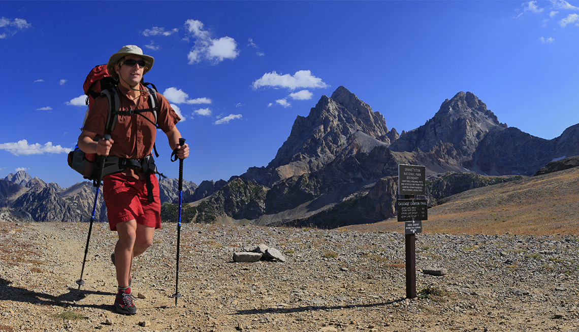 Hiker passing the Alaska Basin-Cascade Canyon divide in Grand Teton National Park
