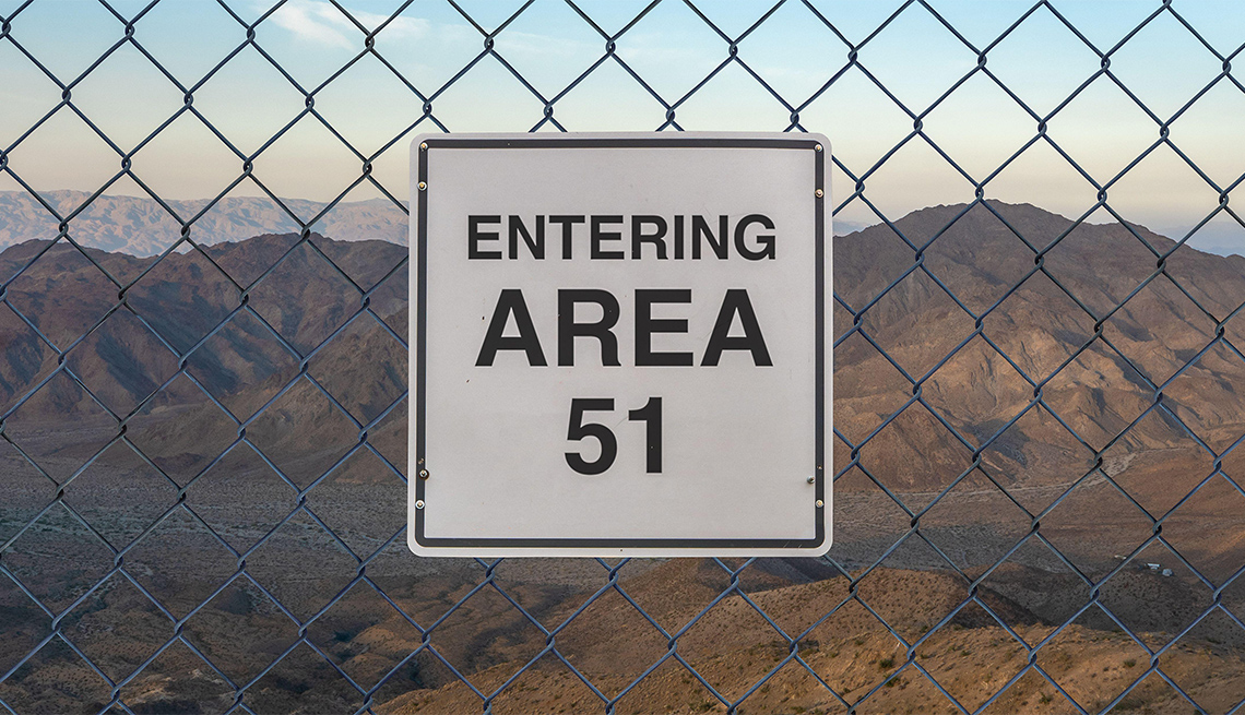 Entering Area 51 sign on a fence at The Military Base in Nevada desert at sunset