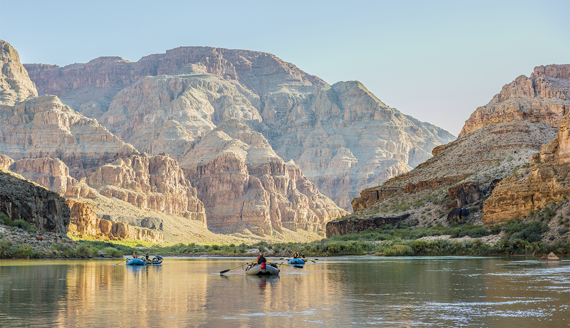 Rafters floating down the Colorado River in the Grand Canyon.