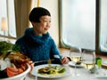 Japanese woman eating a meal on a cruise ship.