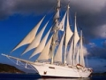Star Clipper seen in full sail, explore the sea with small cruises