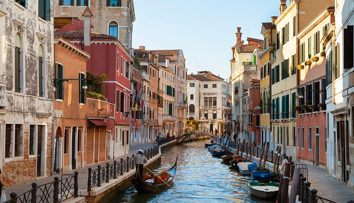 Canal, Gondoliers, Buildings Along Canal in Sunshine, Venice,  A Sentimental Cruise for a Solo Traveler