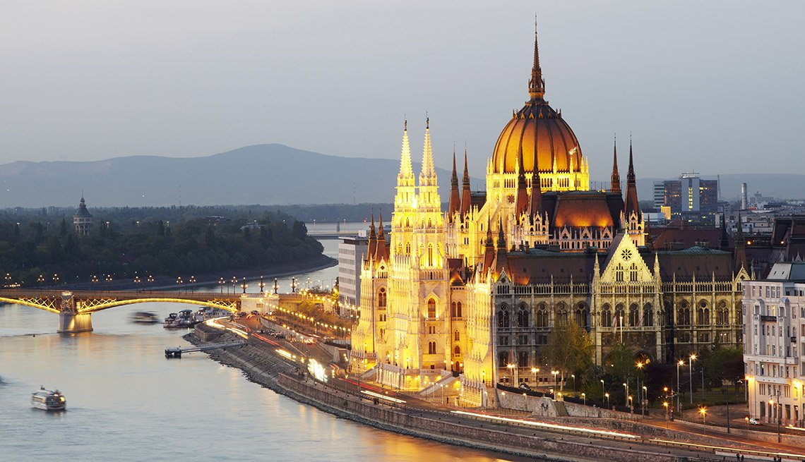 View Of Orszaghaz Parliamentary By The Danube River At Dusk In Hungary,