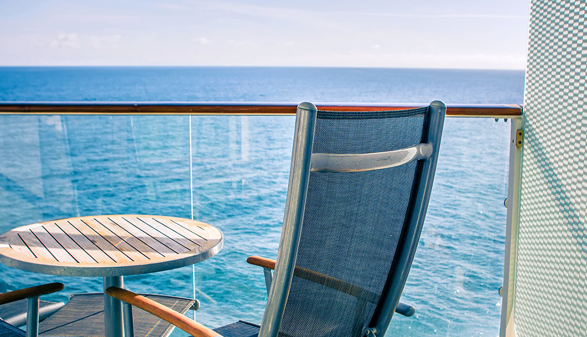 Close up of chair and table on private balcony on cruise ship.