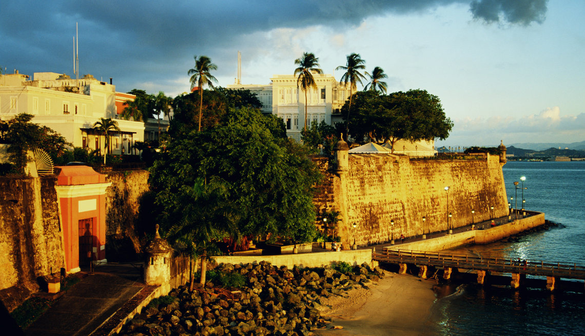 Palm trees and pier around the City Gate in San Juan, Puerto Rico