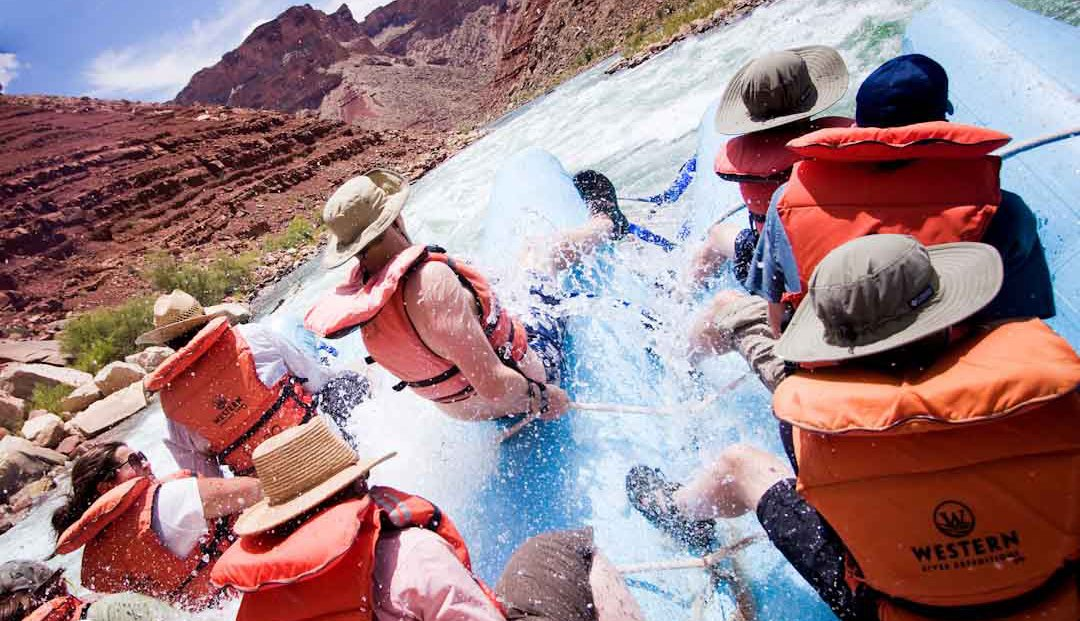 group of people white water rafting in the Grand Canyon