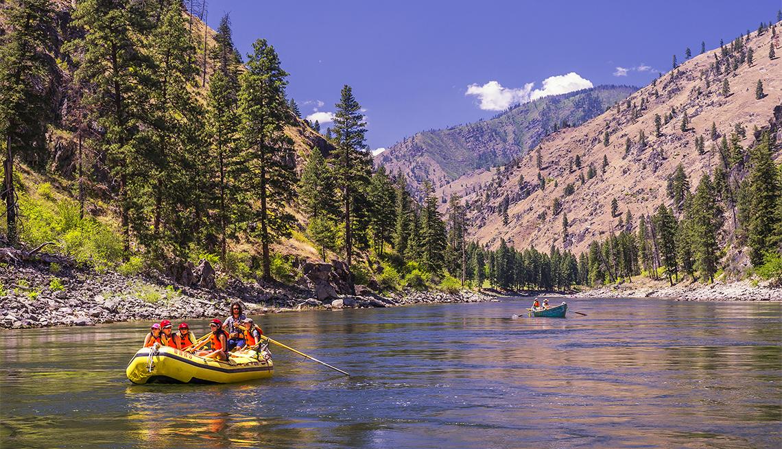 people sailing on a raft