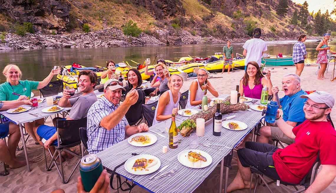 group of travelers eating salmon for the Salmon Six-Day River Rafting Utah trip