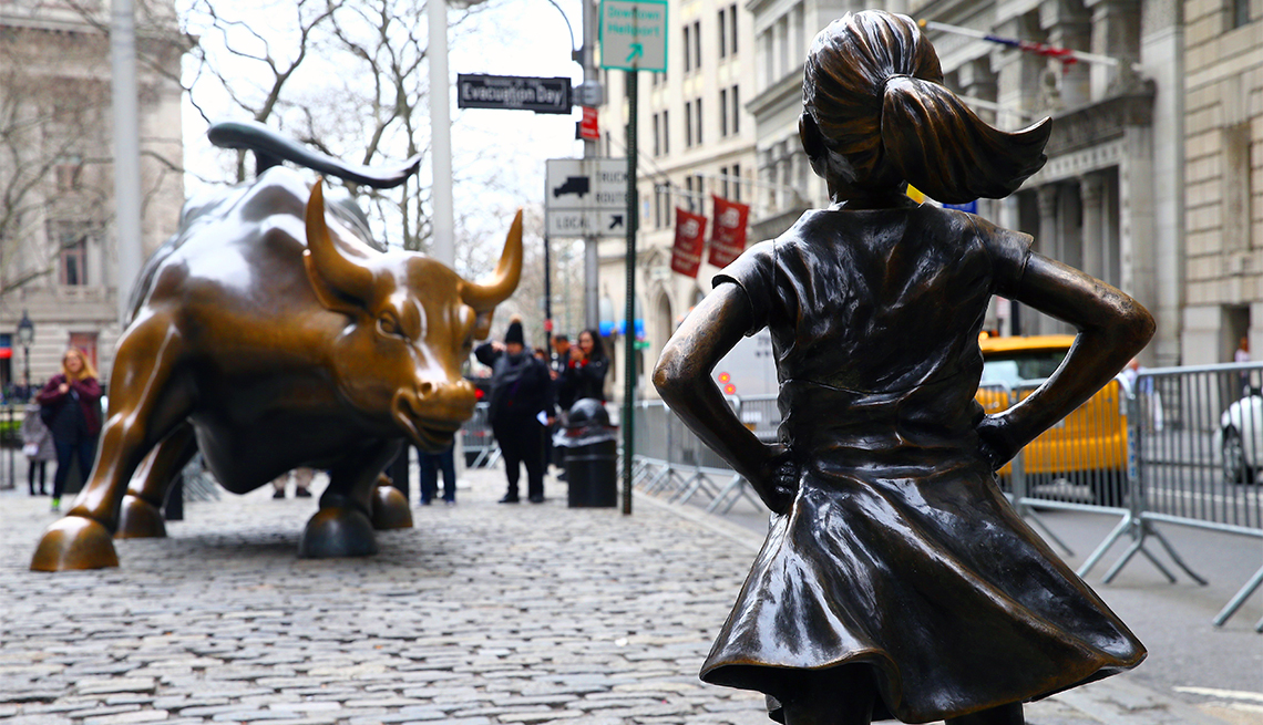 item 2 of Gallery image - 'Fearless Girl' statue face off Wall Street Bull in New York