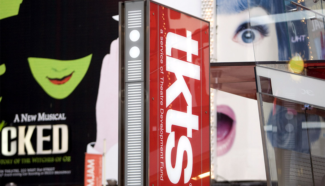 item 3 of Gallery image - Signs advertise Broadway shows and the TKTS discount ticket