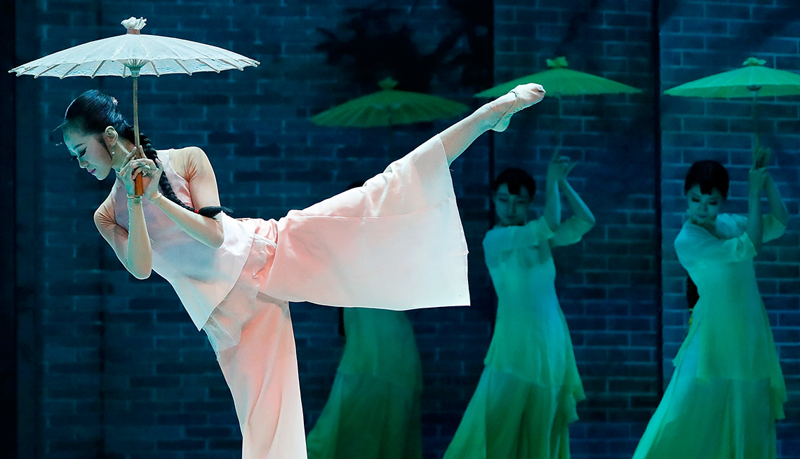 item 9 of Gallery image - ballerina holding umbrella, dancing in foreground, three dancers behind her