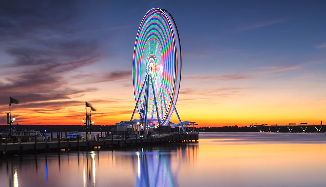 item 10 of Gallery image - twilight view of national harbor with lit ferris wheel