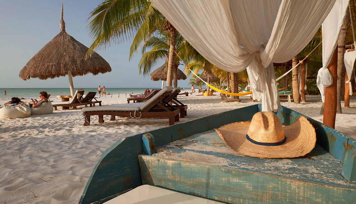 people relax on the beach at Holbox Island
