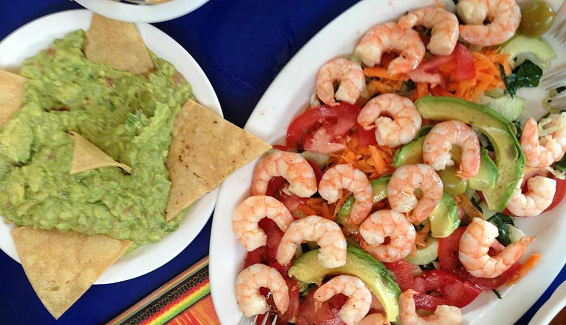 item 5 of Gallery image - a shrimp dinner served at Pescaditos restaurant