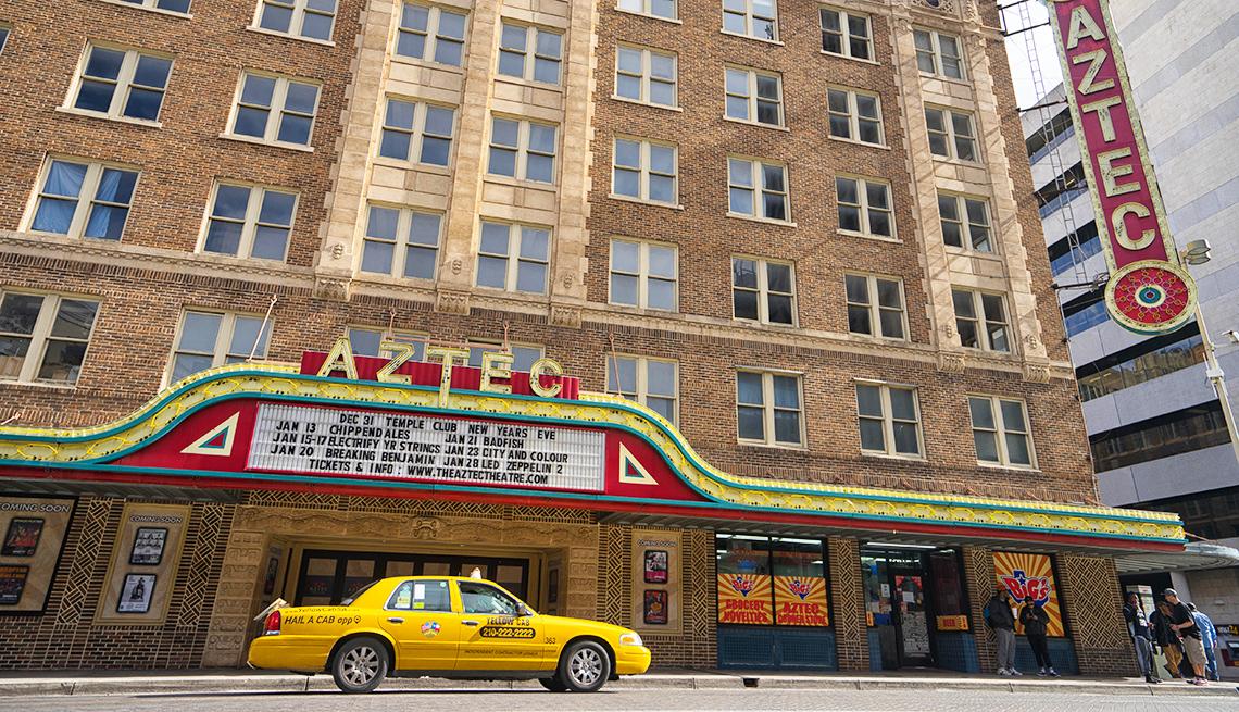 Yellow taxi in front of Aztec Theater San Antonio Texas