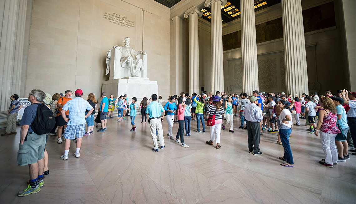 WASHINGTON DC - JULY 30, 2014: Crowds of tourists visit the statue of Abraham Lincoln at the Lincoln Memorial.