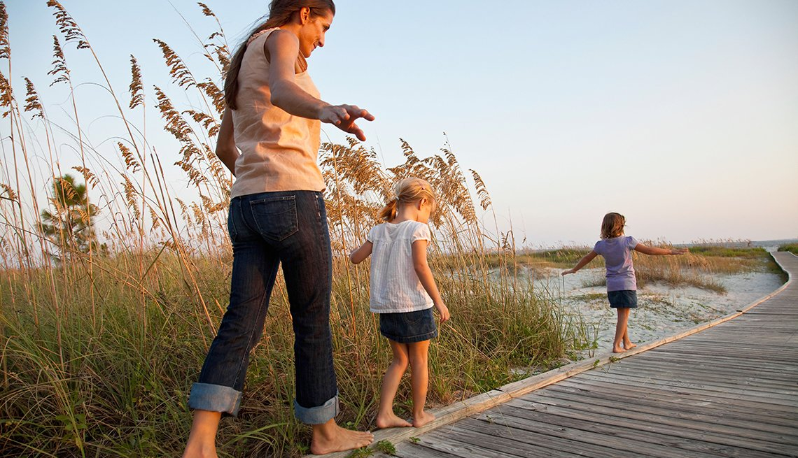 a family walks the beach in Hilton Head South Carolina
