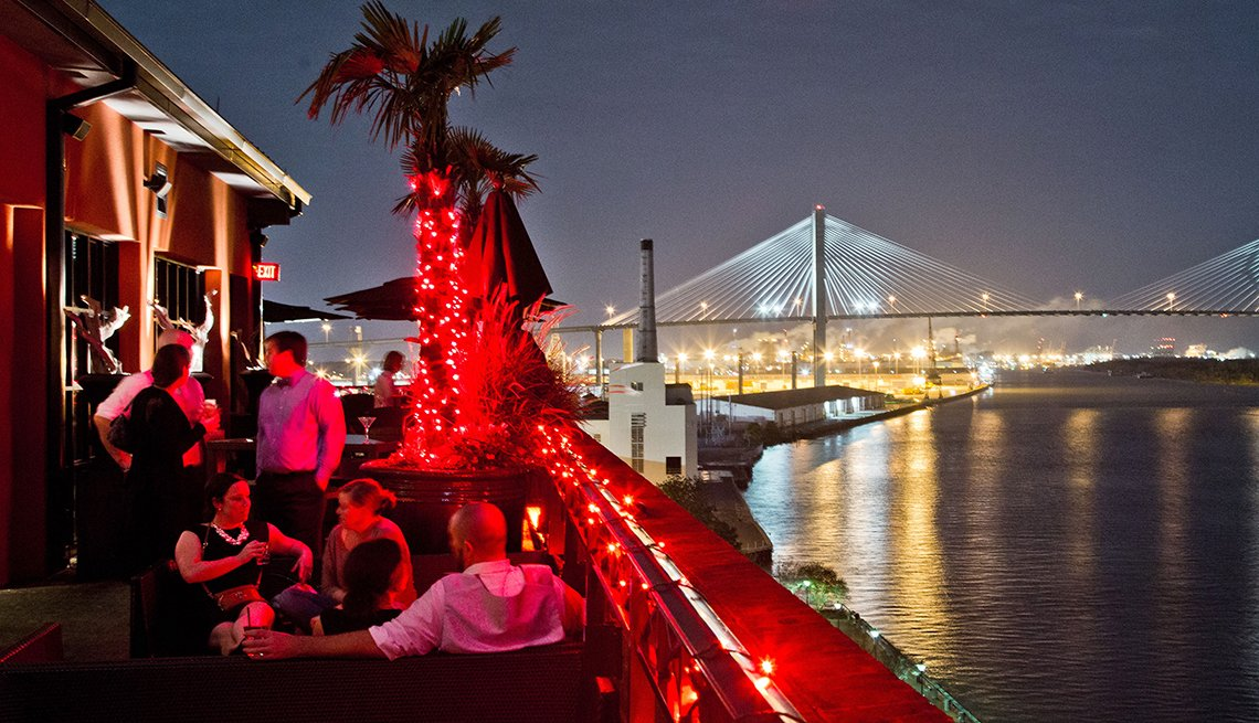 people dine on a roof top in Savannah