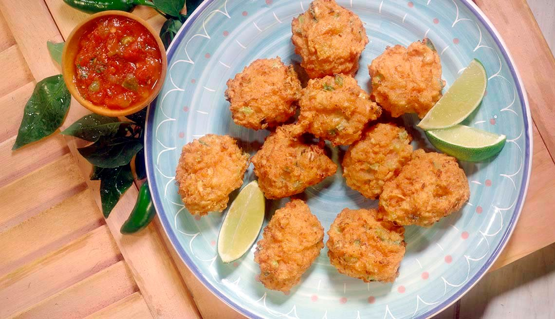 item 4 of Gallery image - Conch fritters on platter with lime wedges