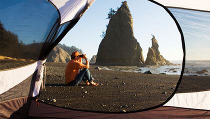 View through tent on black sand beach in Olympic National Park, WA