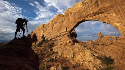 utah's 5 national parks in 5 days arches national park, silhouette taking photo of an arch