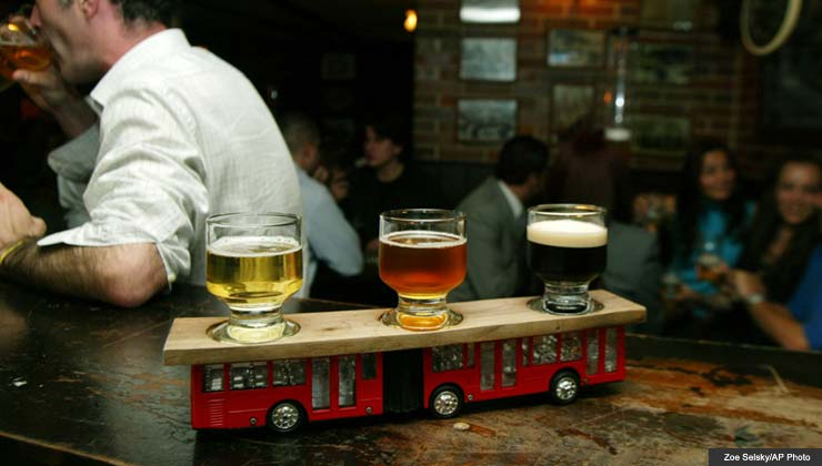 A sampling of three kinds of beer sits atop a toy bus at the Bogota Beer Company in Bogota, Colombia