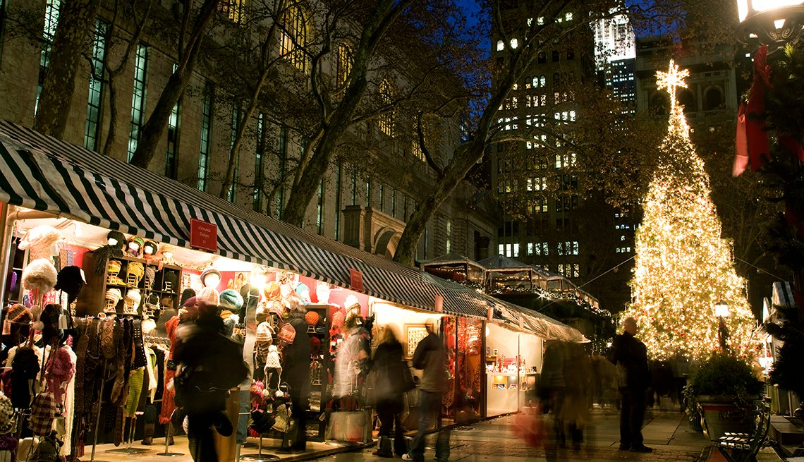Christmas market and large tree at bryant park holiday market in new york, affordable winter vacations