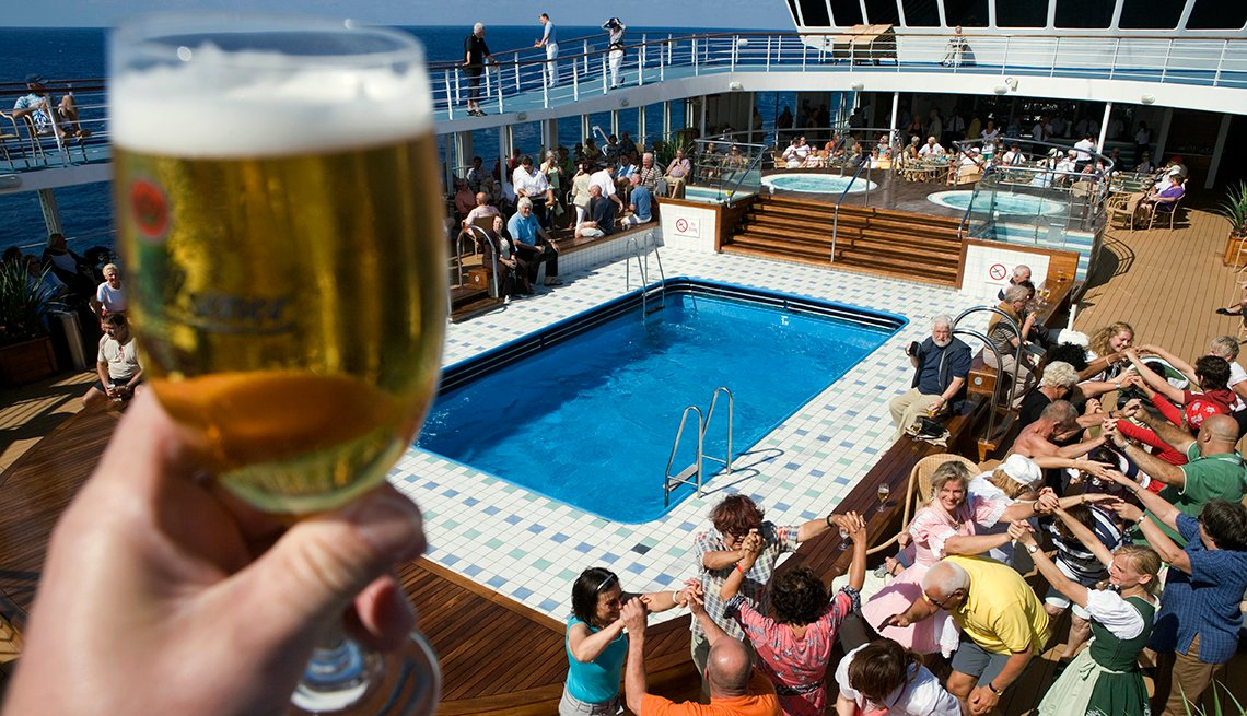 People dance and drink on a cruise ship at sea, affordable winter vacations
