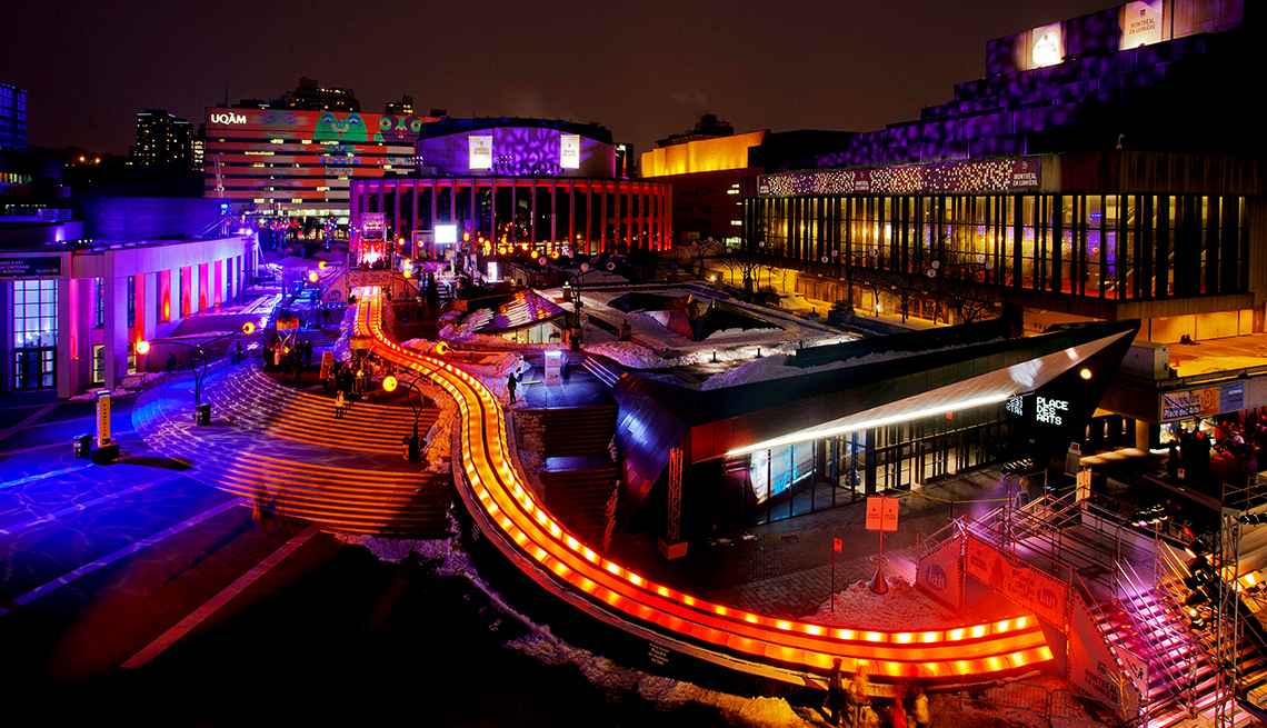 Night time view of Montreal and a giant slide, affordable winter vacations