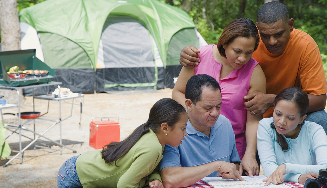 family viewing a map at a campsite