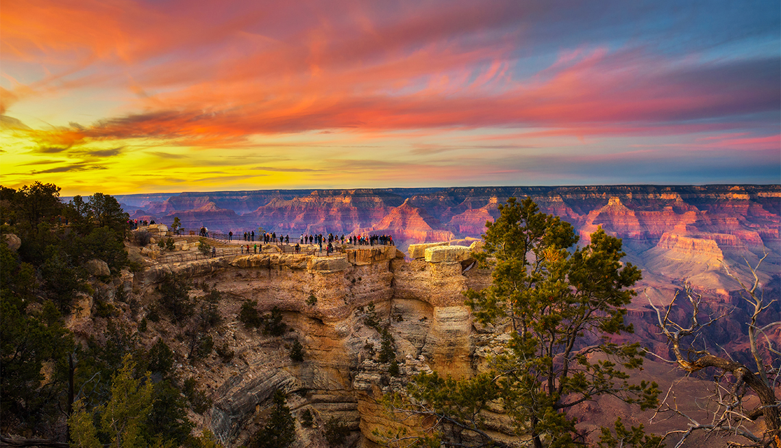 item 4 of Gallery image - Tourists enjoy  beautiful sunset above Grand Canyon National Park from point of view named Mather Point, Grand Canyon