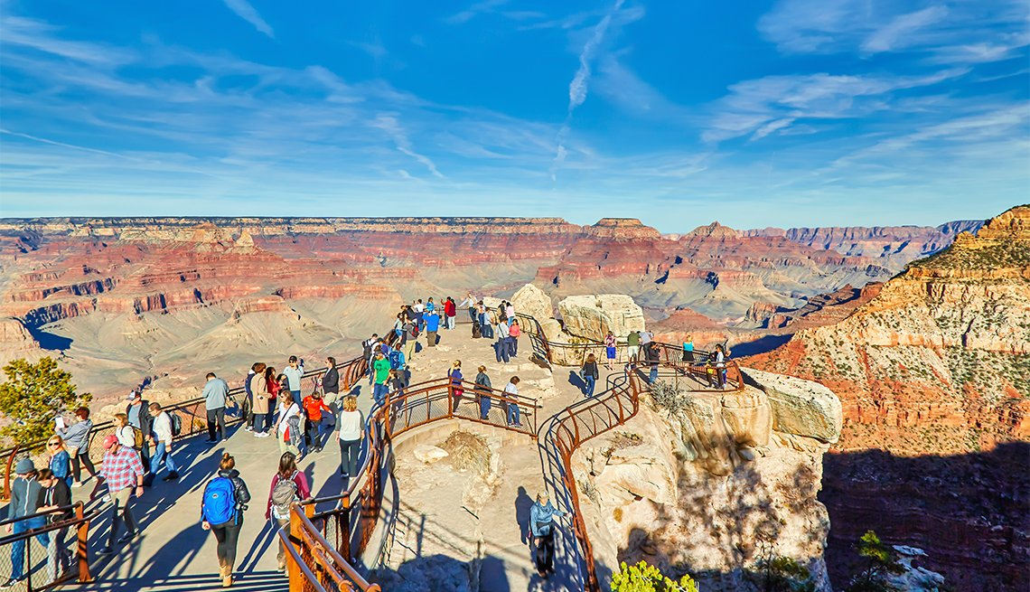 item 2 of Gallery image - Tourists enjoying the view at Mather Point in Grand Canyon National Park