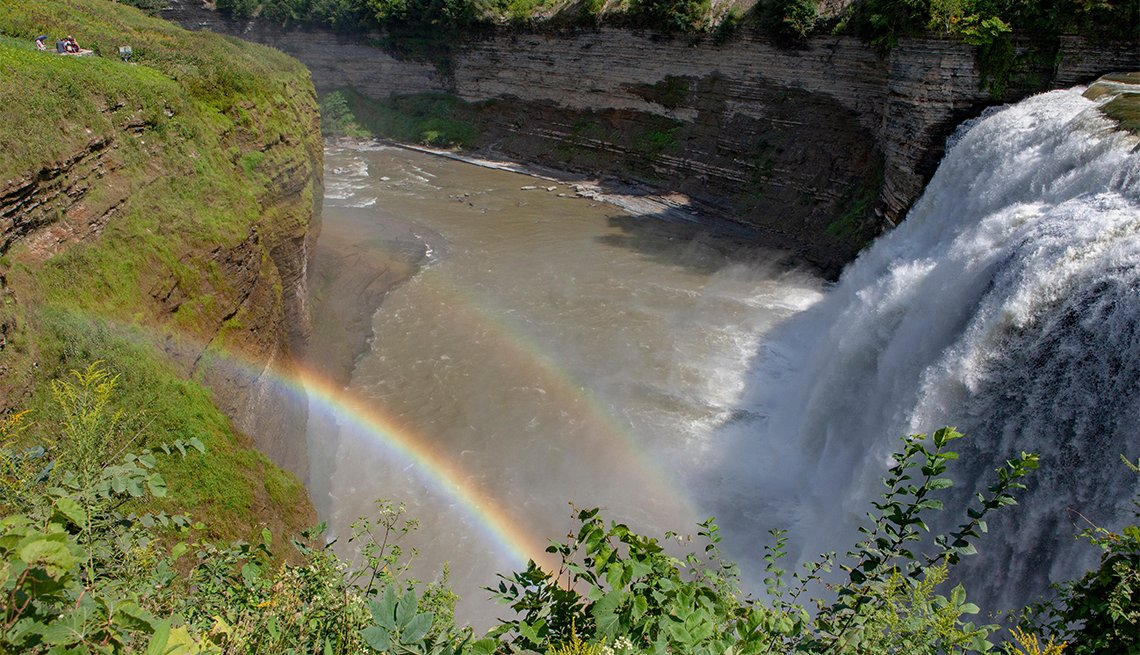 item 13 of Gallery image - A double rainbow forms in the spray from the Middle Falls waterfall at Letchworth State Park