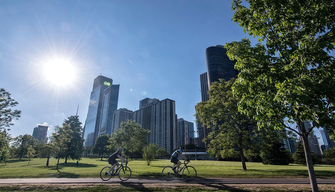 Bicycle riders on Lakefront Trail with the Chicago skyline