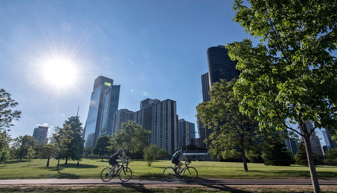 item 1 of Gallery image - Bicycle riders on Lakefront Trail with the Chicago skyline