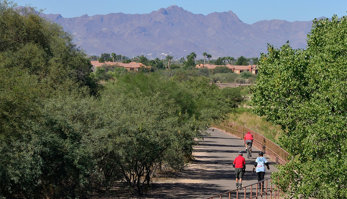Outdoor enthusiasts traverse The Loop at the Rillito River Park west of Craycroft Road in Tucson, Arizona