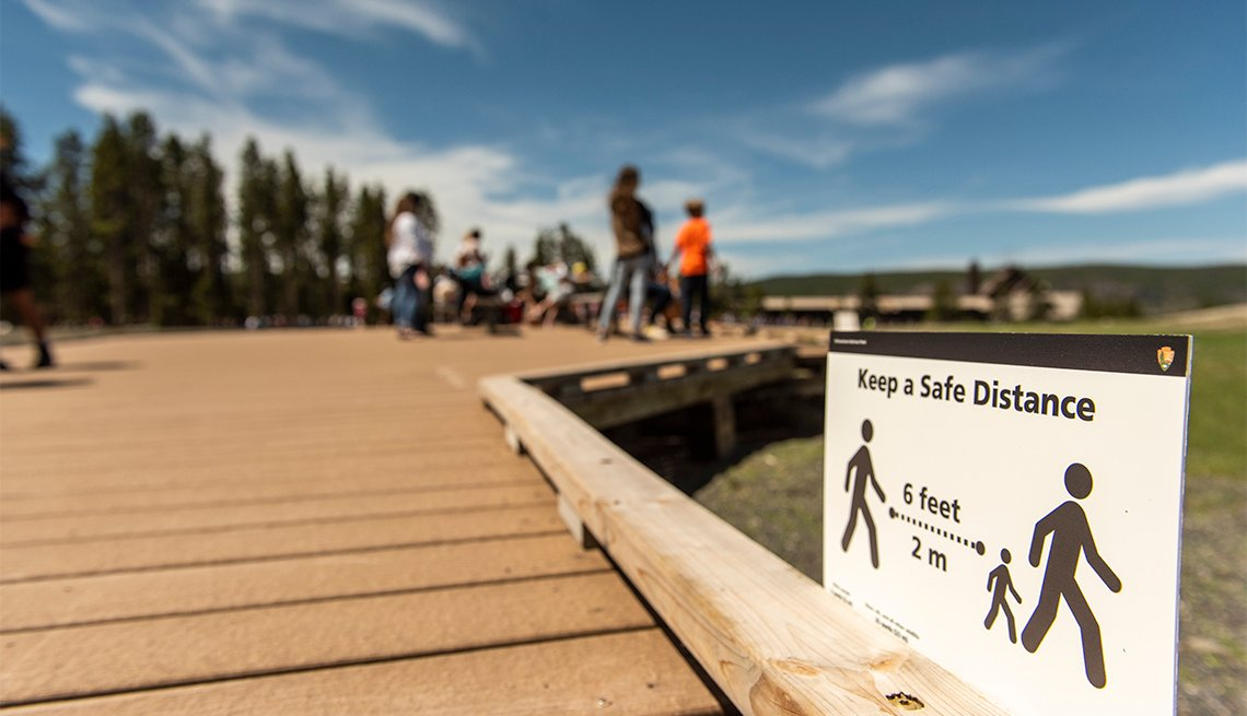 a social distancing sign at Yellowstone National Park