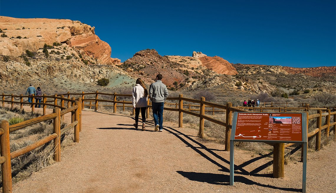 People walking on the Delicate Arch Viewpoint trail in Arches National Park