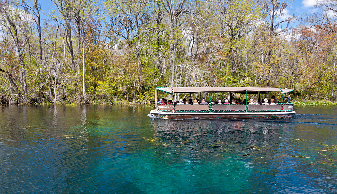 Visitors take boat ride on Silver River at Silver Springs State Park in Ocala, Florida