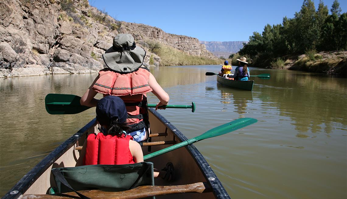 Family enjoying canoeing on the Rio Grande River