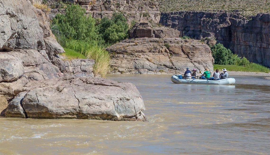 item 2 of Gallery image - people rafting along Rio Grande River
