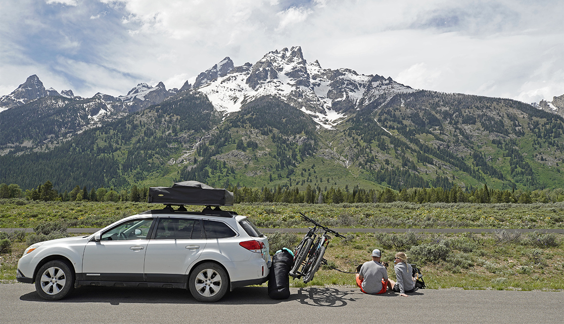 A couple parks on the side of the road to have lunch in Grand Teton National Park