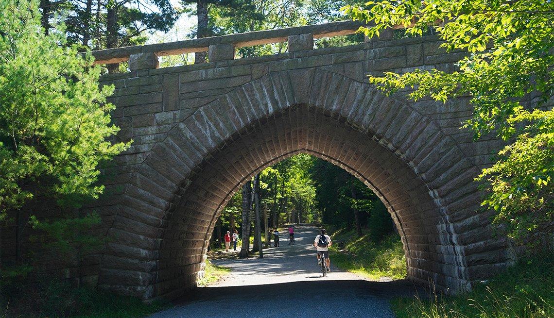 item 6 of Gallery image - bicyclists along Eagle Lake at Acadia National Park